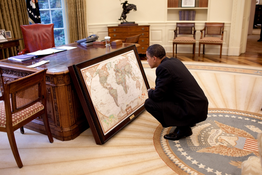 President Barack Obama looks at a map donated to the White House by the National Geographic Society, in the Oval Office, June 10, 2009. (Official White House Photo by Pete Souza) This official White House photograph is being made available for publication by news organizations and/or for personal use printing by the subject(s) of the photograph. The photograph may not be manipulated in any way or used in materials, advertisements, products, or promotions that in any way suggest approval or endorsement of the President, the First Family, or the White House.